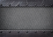 Metal mesh reinforced plates and rivets, background. Steel mesh pattern with metal plates and rivets stock photo