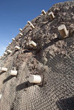 Metal mesh rockfall barriers Royalty Free Stock Photos