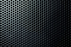 Metal mesh. Metal mesh with round black holes close up Royalty Free Stock Photography