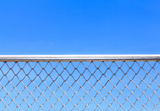 Metal mesh and sky Royalty Free Stock Images