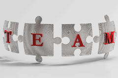 Metal Mesh team puzzle pieces. Four puzzle pieces rendered metal mesh. Concept for team and teamwork Stock Image