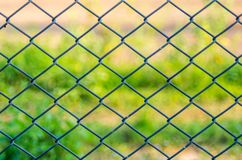 Metal mesh wire fence Stock Images