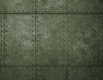 Metal military green background with rivets. Metal armor green armor background with rivets stock photo