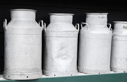 Metal milk churns stand in row Stock Image
