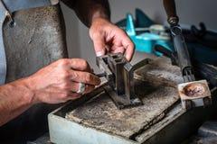 Metal Mold and Crucible at Goldsmith Workshop royalty free stock photos