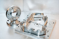 Metal mold and steel flanges. Milling industry. CNC technology. Royalty Free Stock Photography
