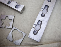 Metal molds. Detail of molds with different forms Royalty Free Stock Image
