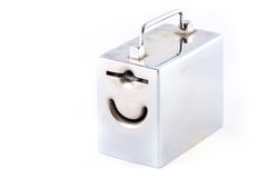 Metal money box and coin. Over white Stock Photo