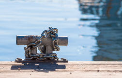 Metal mooring and chain Royalty Free Stock Photos