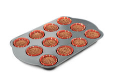 Metal muffin pan isolated Royalty Free Stock Photo