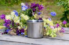 Metal mug with flowers Stock Image