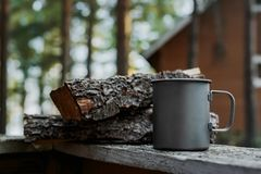 Metal mug in the nature next to the wood stock photo