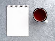 Metal mug with tea, empty a blank sheet of Notepad on the spiral Royalty Free Stock Photos