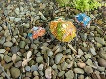 Metal mushrooms in rock garden stock images