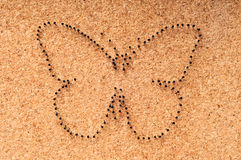 Metal nail heads in shape of butterfly. Stock Image