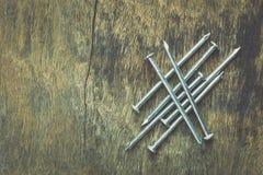 Metal nail on wood Royalty Free Stock Photos
