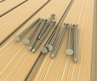 Metal nails in wooden boards Royalty Free Stock Photos
