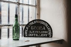 Metal name sign inside Brora distillery, Scotland. The distillery is currently being refurbished to reopen in 2020 stock image