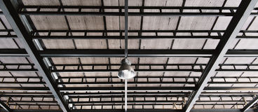 Metal net lamp hanging under zinc roof Royalty Free Stock Photos