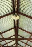 Metal net lamp hanging under zinc roof Royalty Free Stock Photos