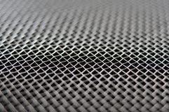 Metal net macro. Macro of metal wire grid abstract background Stock Image