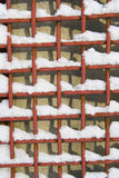 Metal net with snow. In cell Royalty Free Stock Photos