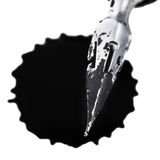 Metal nib of drawing pen and black ink blot Stock Image