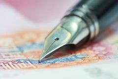 Metal Nib Pen on china money bill Stock Photos