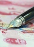Metal Nib Pen on china money bill Royalty Free Stock Images