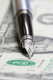 Metal Nib Pen on dollar bill Stock Photo