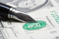 Metal Nib Pen on dollar bill Stock Photography