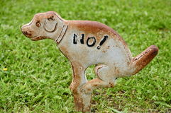 Cast iron No Dog Pooping Sign Royalty Free Stock Image