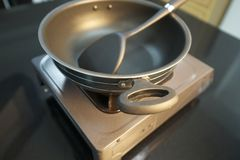 Metal NonStick pot with Gas single Burner Stock Photo