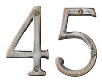 Metal numbers. Aged metal numbers with screw heads Royalty Free Stock Photos