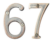 Metal numbers. Aged metal numbers with screw heads Stock Images