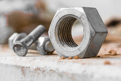 Metal nut and screw closeup Stock Images