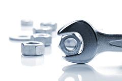 Metal nut in spanner Royalty Free Stock Photography