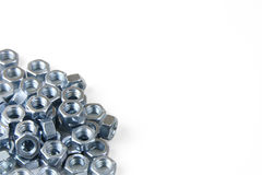 Metal nuts. A heap of metal nuts Stock Photos