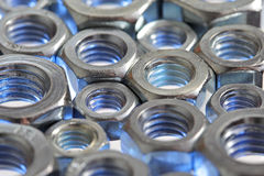 Metal nuts background Stock Photography