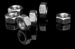 Metal nuts on black Stock Images