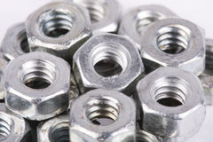 Metal nuts close up. On white Royalty Free Stock Photo