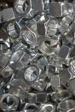 Metal nuts for connecting iron and wood parts stock images
