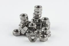 Metal nuts. Macro of metal nuts and screws Stock Images