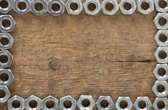 Metal nuts tool on wood Royalty Free Stock Photography
