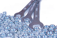 Metal nuts and wrench Royalty Free Stock Photo