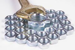 Metal nuts and wrench Royalty Free Stock Images