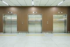 Metal office building elevator doors. Office interior Stock Photos