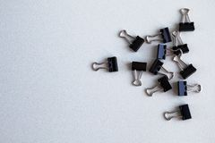 Metal office clips scattered on a white background.  stock photo