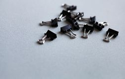 Metal office clips scattered on a white background.  stock images