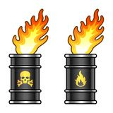 Metal oil barrels in flame with danger signs Royalty Free Stock Photos